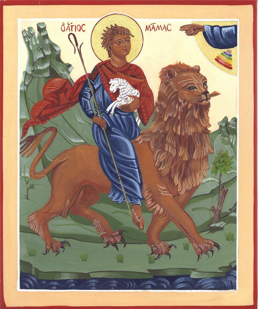 De Heilige Sint Mamas. De herdersjongen St. Mamas is een martelaar uit Ceserea te Cappadocië. Hij zou bij vervolgingen de bergen zijn ingevlucht en daar monnik geworden. Hij las daar iedere dag aan de dieren voor en zo werden de wilde beesten zijn vrienden. Toen werd hij toch gevonden en de soldaten moesten hem ter dood brengen, maar die waren zo onder de indruk van zijn meesterlijke relatie met de dieren, dat ze zich bekeerd hebben. De heilige St. Mamas, zit op een leeuw met een lam op zijn schoot. Het leven met de dieren doet herinneren aan het paradijs voor de zondeval ook aan Jezus in de woestijn, zie Marcus 1 vers 13.