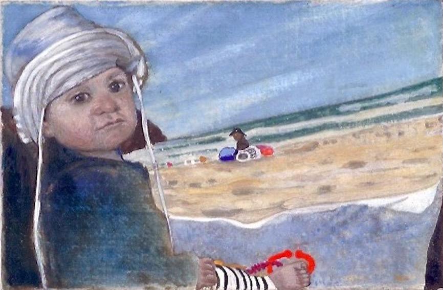 Kindje met zinnenhoedje op het strand in California.